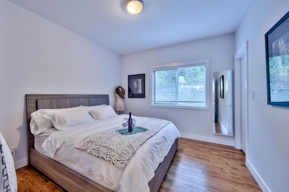 Second bedroom with wood floor in modern home