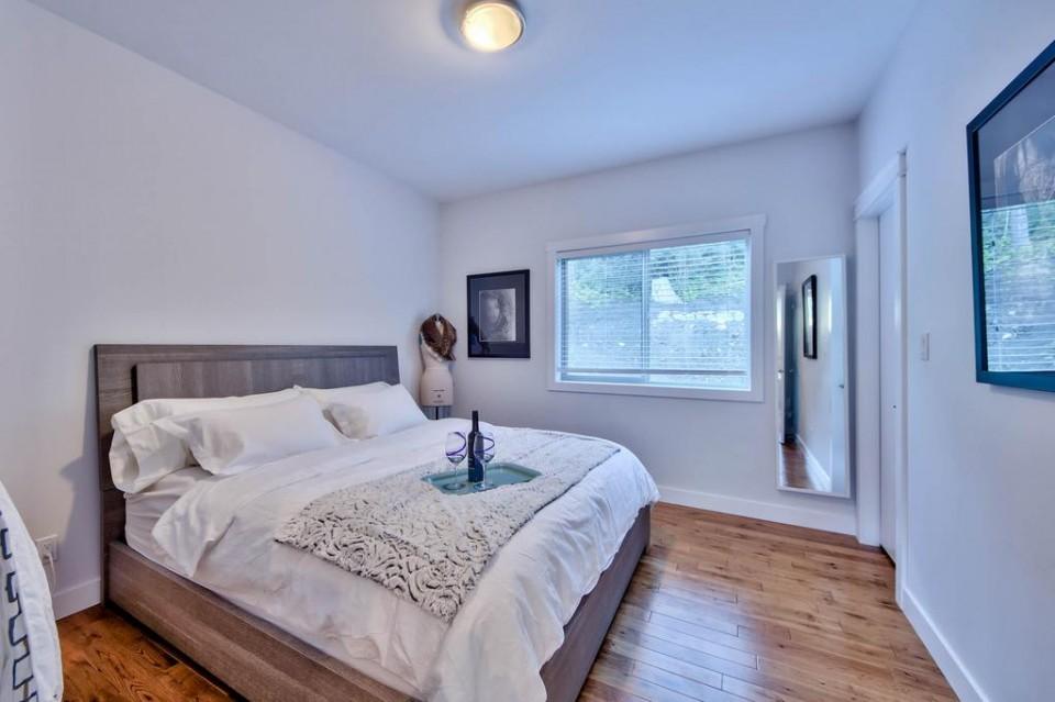 Second bedroom with wood floor in modern home
