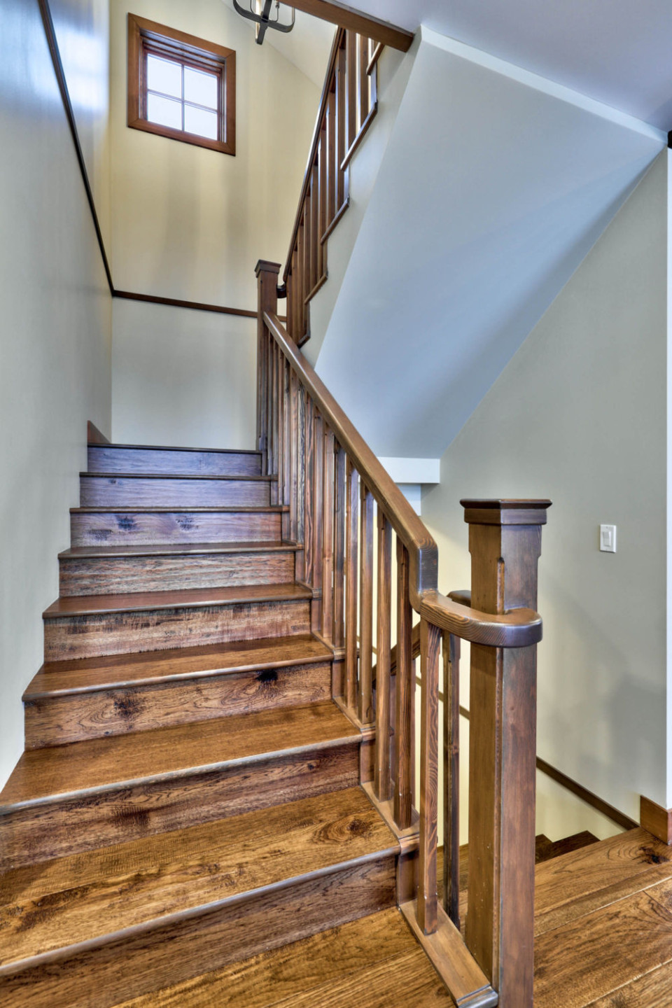 Staircase heading upstairs in a timber frame log home