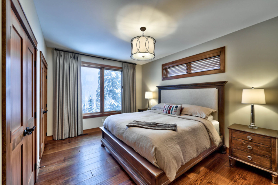 Master bed in a timber frame log home