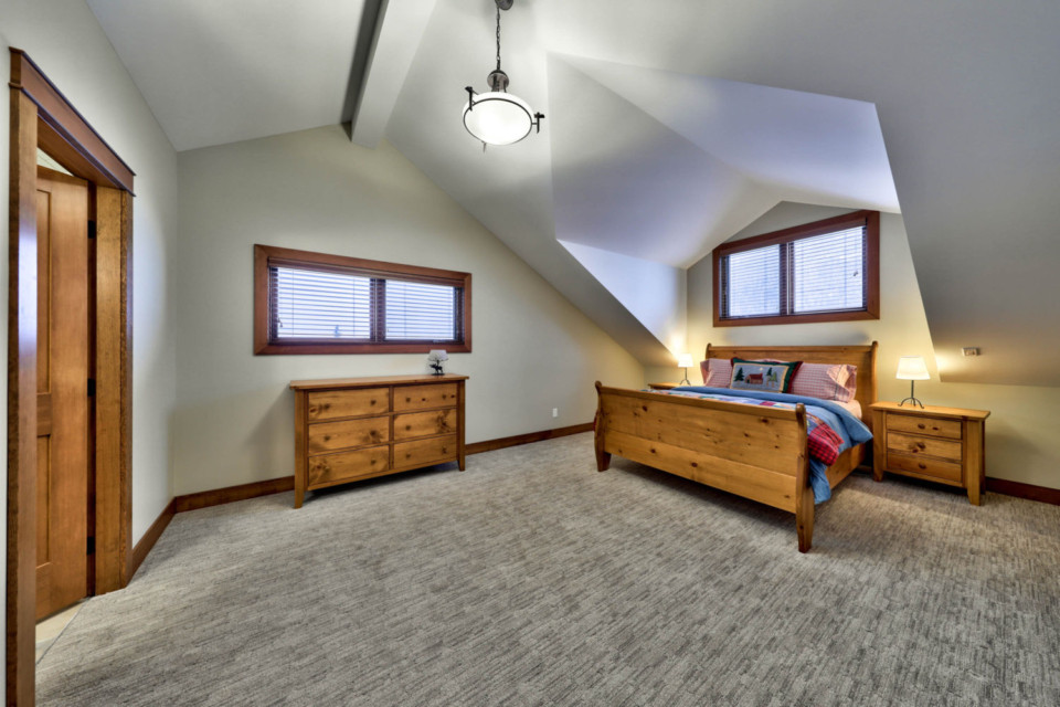 Fourth bedroom with vaulted ceilings in a timber frame log home