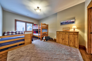 Rec room with bunk beds in timber frame log home
