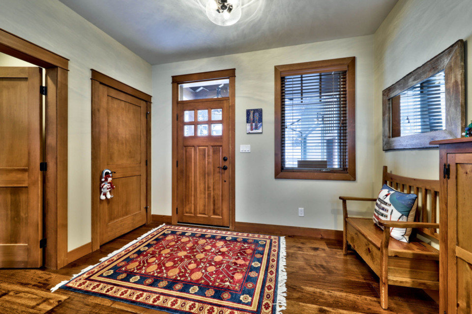 Inside entryway in a timber frame log home